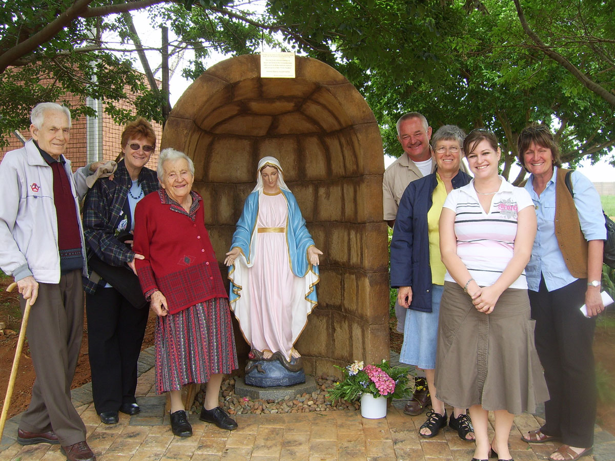 Danny and Domitilla with family members at the unveiling of Our Lady's statue and grotto at Elvira Rota Village in 2007