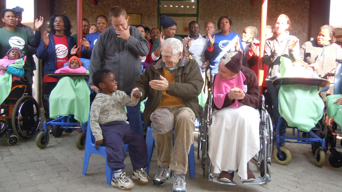 Danny-being-greeted-by-LITTLE-EDEN-staff-and-residents-on-his-90st-birthday-celebration-in-2011