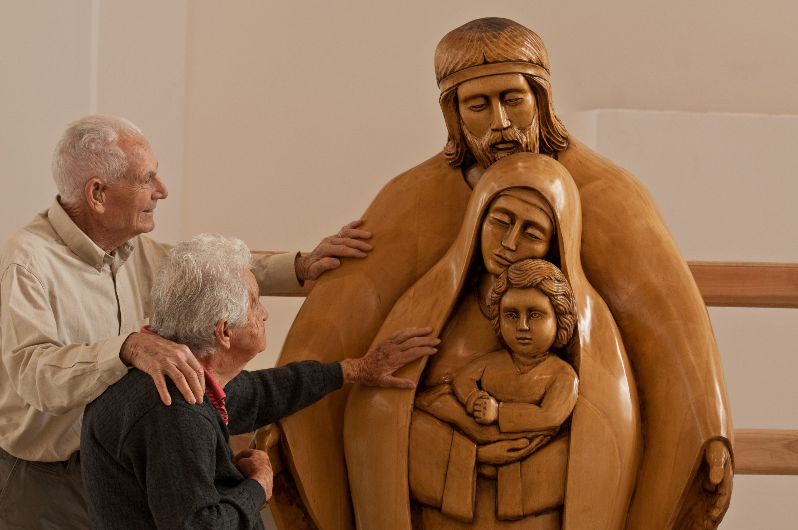 Danny and Domitilla welcoming the Holy Family statue just before installation in the Elvira Rota Village Chapel in 2010